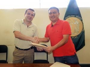Foto convenio con UCSS y Unión Comercio